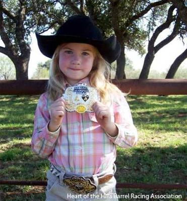 Sterling Smith shows off her winning buckle at the Heart of the Hills Barrel Racing Association in the 8 & under Barrel division