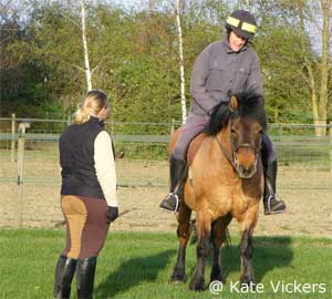 Kate Vickers providing riding instruction
