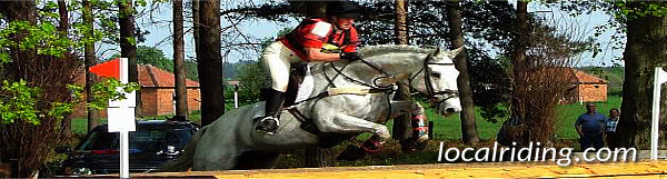 sport of equestrian eventing - cross country jumping