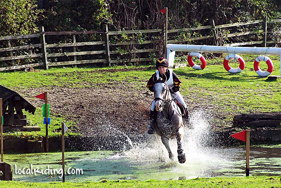 Taking on the water obstacle at Caistor Equestrian